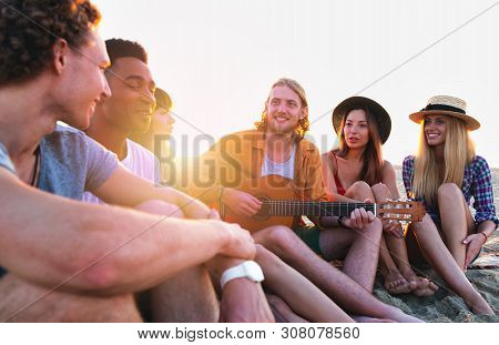 Happy Group Of Friend Having Party On The Beach