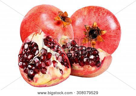 Fresh Ripe Whole And Cut Pomegranate Isolared