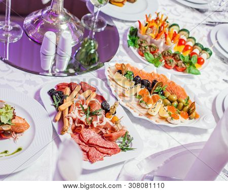 Wedding Table Served With Tasty Meals, Antipasto Platter Cold Meat, Fish Platter, Cheese Platter. Ho