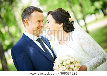 wedding. bridegroom or fiance portrait with bride in park