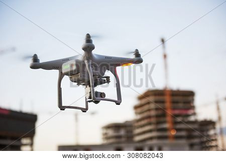 drone quadcopter with digital camera in city