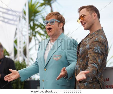 CANNES, FRANCE - MAY 16, 2019: Elton John and ActorTaron Egerton  attend  the photocall for