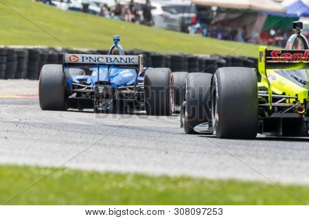 June 23, 2019 - Elkhart Lake, Wisconsin, USA: SCOTT DIXON (9) of New Zealand races through the turns during the  race for the REV Group Grand Prix at Road America in Elkhart Lake, Wisconsin.