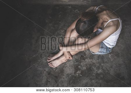 Women Sitting On The Floor Crying With Depression, Depressed Woman, Family Problems, Stress, Kitchen