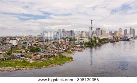 Slums Of Poor People On The Background Of A Big City. The City Of Manila, Poor And Poor Areas. Contr