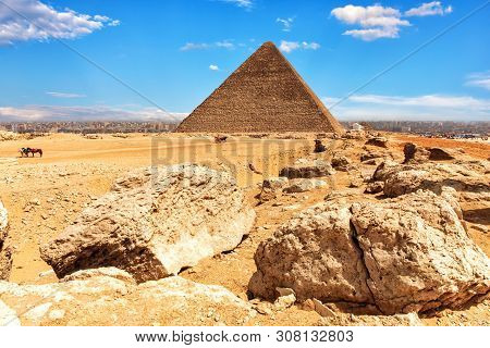 The Pyramid Of Cheops And Stones In The Desert Of Giza, Egypt