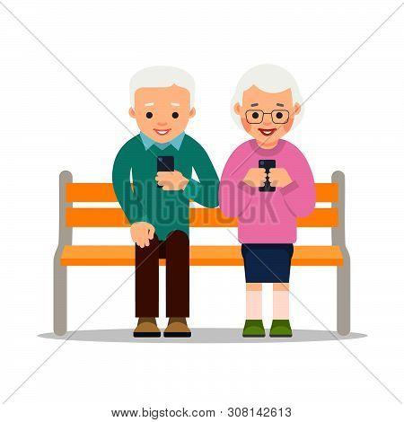Old People On Phones. Couple Of Elderly Pensioners Sit On A Bench In Park. Aged Person Chat With Fri