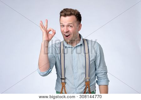 Happy Young Man In Shirt And Suspenders Gesturing Ok Sign