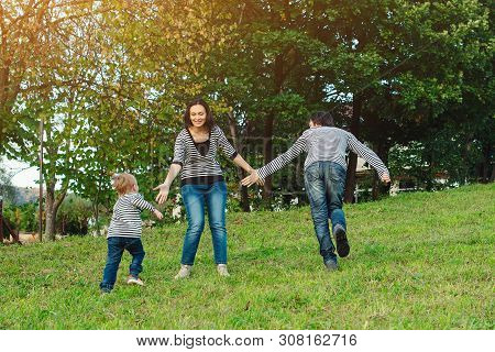 Happy Family Having Fun Outdoors.young Family Enjoying Life, Together On Nature. Happy Family Lifest
