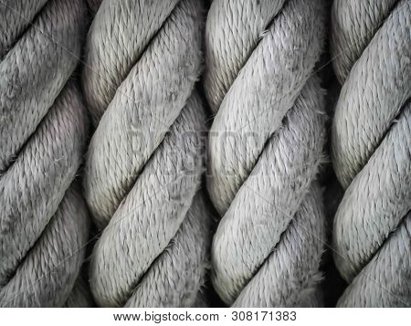 Close-up Of An Old Frayed Boat Rope As Background, Spiral Of Rope, Coiled Rope On Boats Deck.