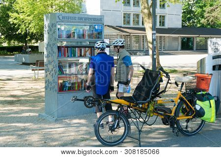 Solothurn, So / Switzerland - 2 June 2019: Biccle Tourists Stop And Enjoy The Books At One Of The Fr