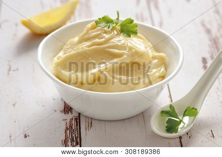 Mayonnaise Sauce. Classic French Cuisine Sauce Made From Vegetable Oil, Yolk And Vinegar. Served In