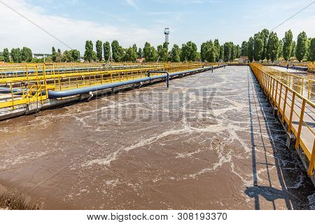 Modern urban wastewater and sewage treatment plant with aeration tanks, industrial water recycling and purification. poster
