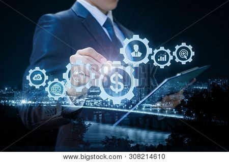 The Businessman Is Involved In Business Management On Virtual Screen.