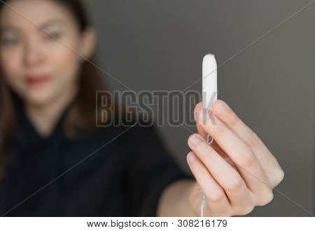 Woman Holding Menstruation Tampon In Hand,menstrual Tampon. Menstruation Time. Hygiene And Protectio
