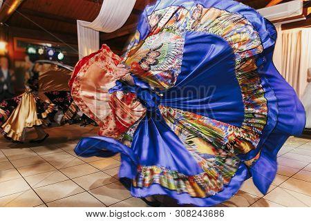 Beautiful Gypsy Girls Dancing In Traditional Blue Floral Dress At Wedding Reception In Restaurant. W