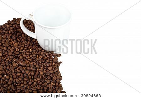 A Cup Near The Coffee Beans