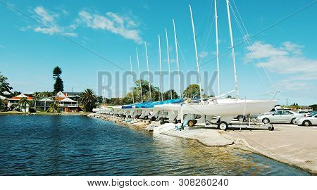 Sailboats On The Waterfront Storage Area At Belmont Sailing Club Marina  Alongside The Calm Waters O