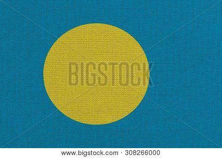 Palau fabric flag. Patriotic background. National flag of Palau poster