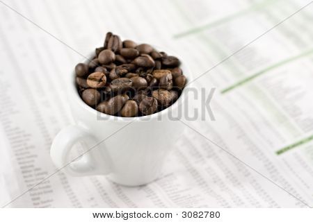 Espresso Cup On Financial Pages