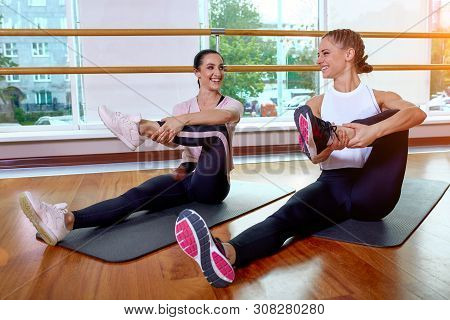 Fitness Group Does Exercises For Stretching Muscles In A Fitness Lesson. Group Fitness Concept, Grou