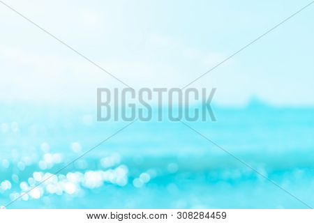 Blur Tropical Beach With Bokeh Sun Light Wave Abstract Background.