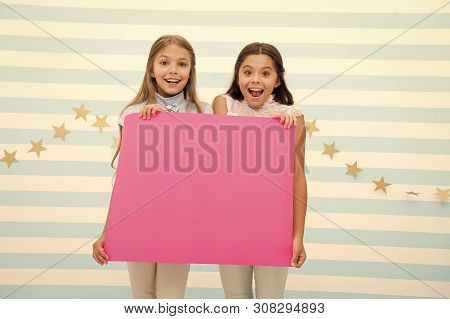 Amazing Surprising News. Girl Hold Announcement Banner. Girls Kids Holding Paper Banner For Announce