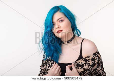 poster of People and fashion concept - Young woman with choker and blue hair posing over white background