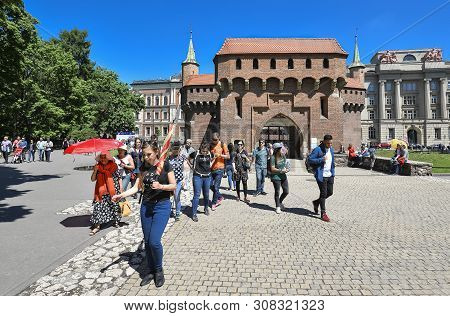 Krakow, Poland - May 20, 2019: The Krakow Barbican - A Fortified Outpost. It Is A Historic Gateway L