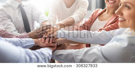 Close Up View Of Young Business People Putting Their Hands Together. Stack Of Hands. Unity And Teamw