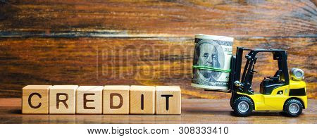 Wooden Blocks With The Word Credit And Forklift. Loan Provided By The Lender To The Borrower At A Ce