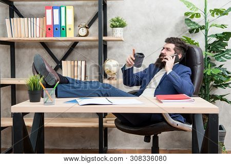 Coffee relaxing break. Man bearded businessman hold cup and smartphone. Coffee is pledge of successful negotiations. Caffeine addicted. Boss enjoying energy drink. Mobile call. Start day with coffee. poster