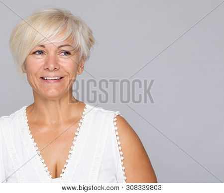Beautiful smiling blonde middle aged woman