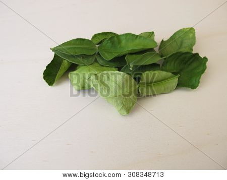 Dried Kaffir Lime Leaves On A Wooden Board