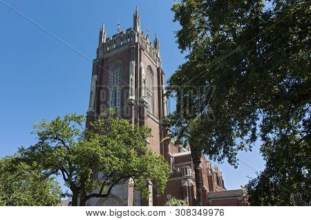 Church And Bell Tower Of Gothic Revival Style Architecture In New Orleans