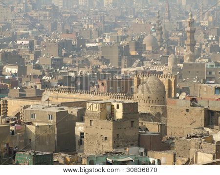 sunny and misty aerial view of Cairo including the Mosque of Ibn Tulun (Egypt) poster
