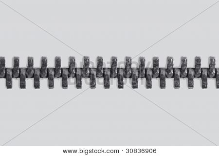 studio photography of a long zipper half closed in light back poster