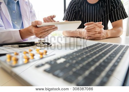 Doctor Explaining For Patient And Showing Medical Records Informations And Diagnosis Patient Symptom