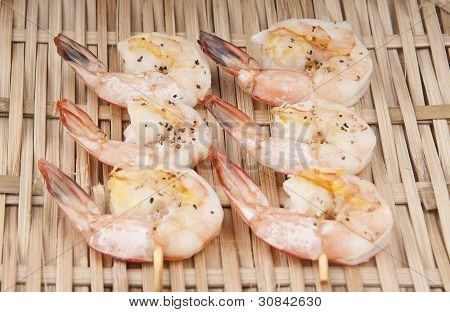 delicious fresh shrimp on a basket peeled with Skewer