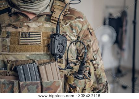 Closeup Photo Shoot Of Military Man In Usa Army Uniform With Radio In His Pocket.