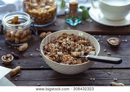 Healthy Lifestyle Breakfast Bowl Plate With Granola And Spoon On Brown Wooden Table Background, Cere