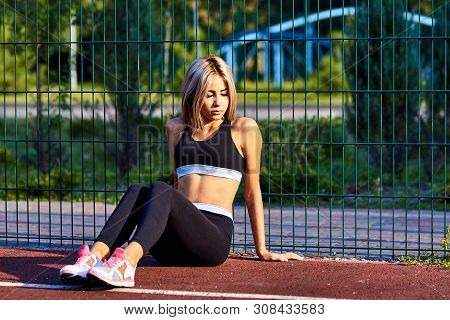 Sport Girl. The Girl Is Doing Fitness Exercises. Beautiful Young Sports Woman Doing Exercises. A Wom