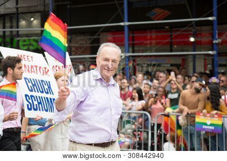 2018 JUNE 24 NEW YORK: Democratic Senate Minority Leader Chuck Schumer and supporters march along the 5th Ave parade route during the NYC Pride March.