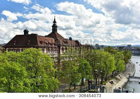 Basel, Switzerland - April 17, 2019. Embankment Of The Rhine River. View Of The Theobald Baerwart Se