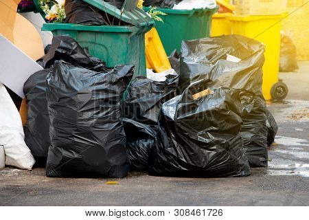 Pile Of  Black Garbage Bags At City Street, Waste Management In Large Cities