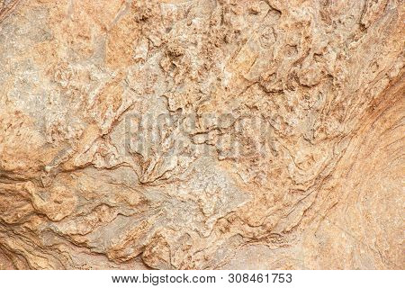 Texture Of Patterns On Natural Brown Stone Background