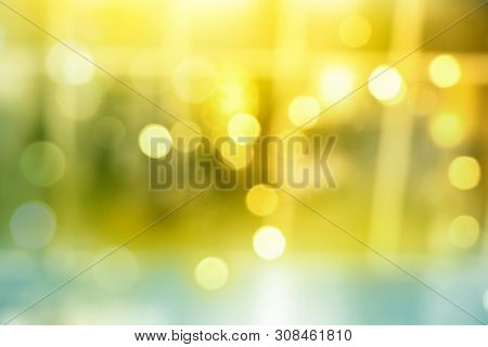 Abstract Blurred Yellow Bokeh Lights In Golden Festive Decoration Background