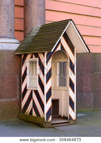 A Wooden Striped Sentry-box On The Street