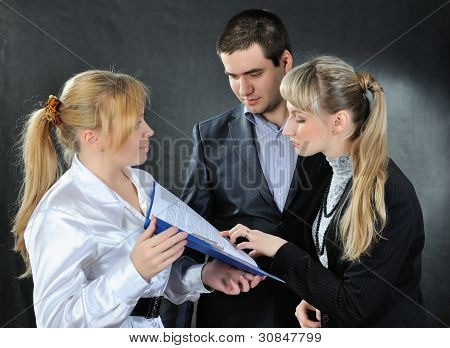 Man And Woman Read The Document.