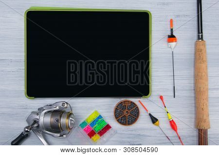 On A Light Background, On The Black Screen Of The Tablet, There Is A Place For Applications And Insc